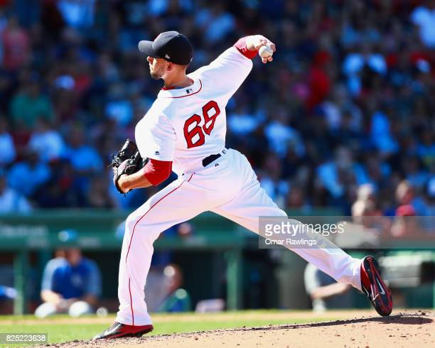 Matt Barnes of the Boston Red Sox pitches at the top of the eighth inning during the game against the Kansas City Royals at Fenway Park on July 30...