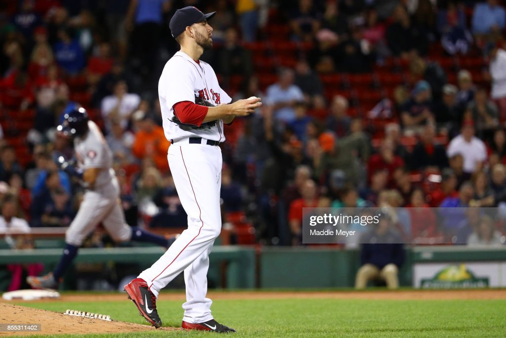 Matt Barnes #68 of the Boston Red Sox reacts after Carlos Correa #1 of the Houston Astros hit a two run home run during the seventh inning at Fenway Park on September 28, 2017 in Boston, Massachusetts.