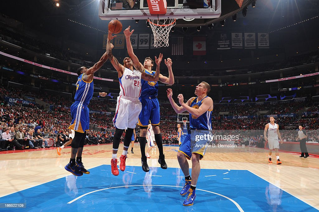 <a gi-track='captionPersonalityLinkClicked' href=/galleries/search?phrase=Matt+Barnes+-+Basketball+Player&family=editorial&specificpeople=202880 ng-click='$event.stopPropagation()'>Matt Barnes</a> #22 of the Los Angeles Clippers attempts a shot against <a gi-track='captionPersonalityLinkClicked' href=/galleries/search?phrase=Andre+Iguodala&family=editorial&specificpeople=201980 ng-click='$event.stopPropagation()'>Andre Iguodala</a> #9 of the Golden State Warriors at STAPLES Center on October 31, 2013 at in Los Angeles, California.