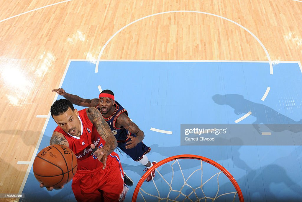 <a gi-track='captionPersonalityLinkClicked' href=/galleries/search?phrase=Matt+Barnes+-+Basketball+Player&family=editorial&specificpeople=202880 ng-click='$event.stopPropagation()'>Matt Barnes</a> #22 of the Los Angeles Clippers drives to the basket against the Denver Nuggets on March 17, 2014 at the Pepsi Center in Denver, Colorado.