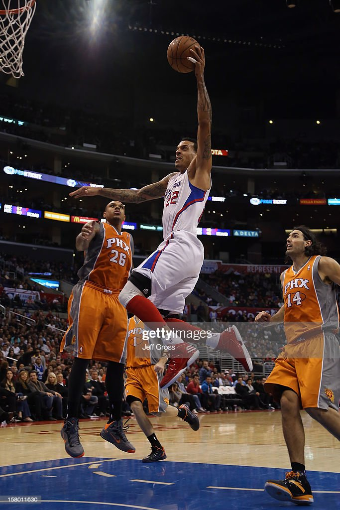 Matt Barnes #22 of the Los Angeles Clippers drives to the basket past Shannon Brown (L) #26 and Luis Scola #14 of the Phoenix Suns for a dunk in the second half at Staples Center on December 8, 2012 in Los Angeles, California. The Clippers defeated the Suns 117-99.