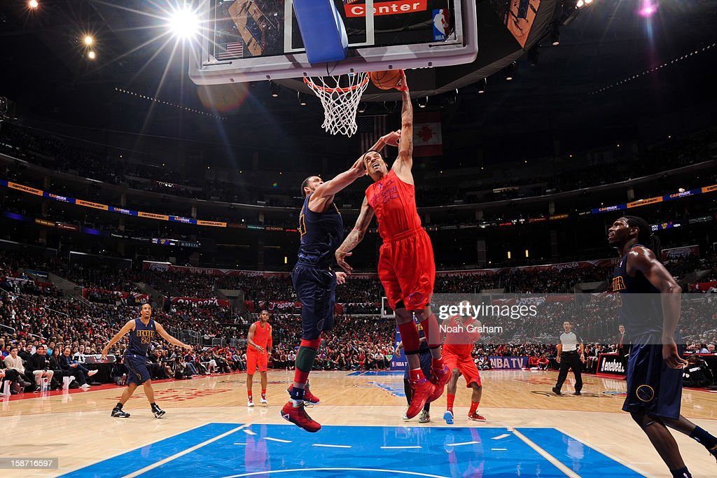 Matt Barnes #22 of the Los Angeles Clippers dunks against JaVale McGee #34 of the Denver Nuggets during a Christmas Day game at Staples Center on December 25, 2012 in Los Angeles, California.