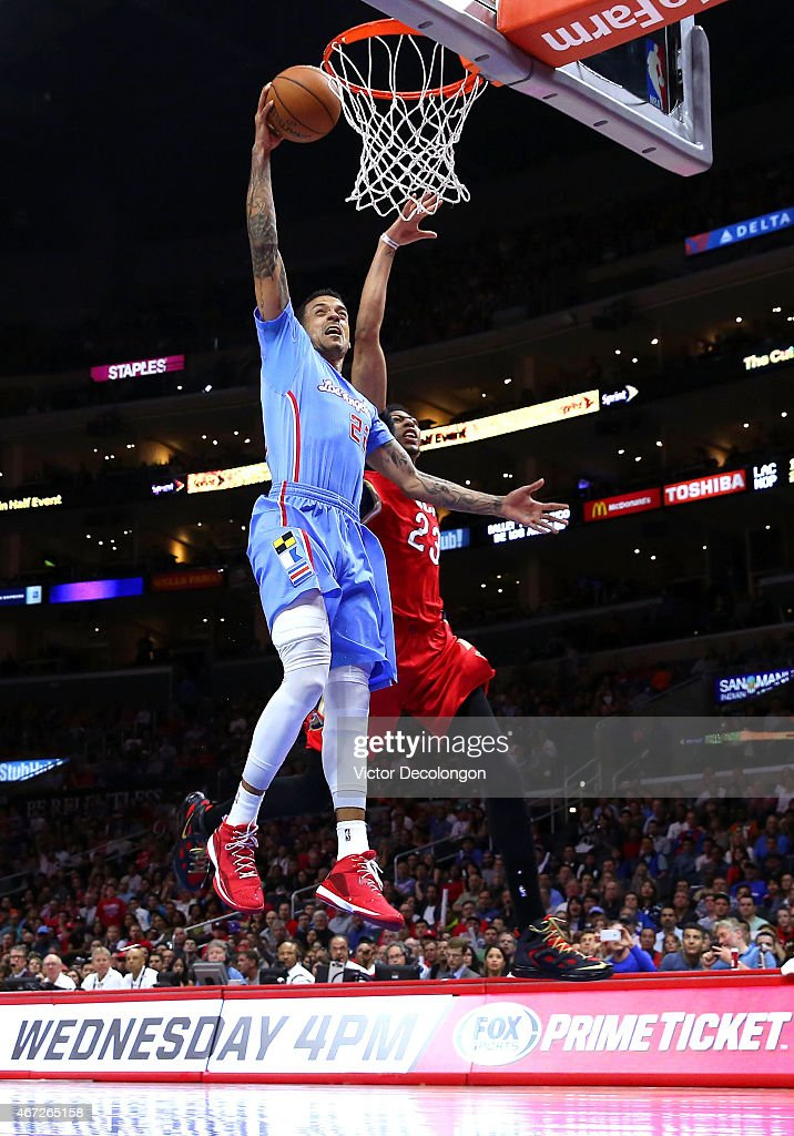 Matt Barnes #22 of the Los Angeles Clippers dunks past Anthony Davis #23 of the New Orleans Pelicans in the first quarter during the NBA game at Staples Center on March 22, 2015 in Los Angeles, California.