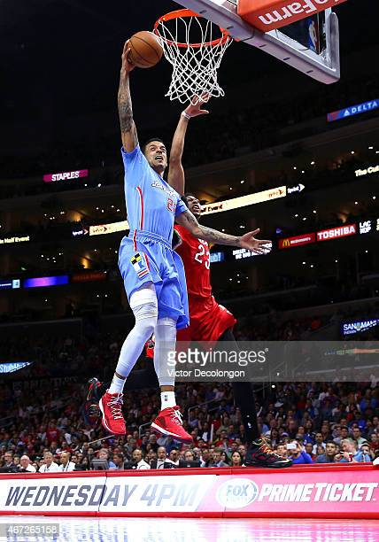Matt Barnes of the Los Angeles Clippers dunks past Anthony Davis of the New Orleans Pelicans in the first quarter during the NBA game at Staples...