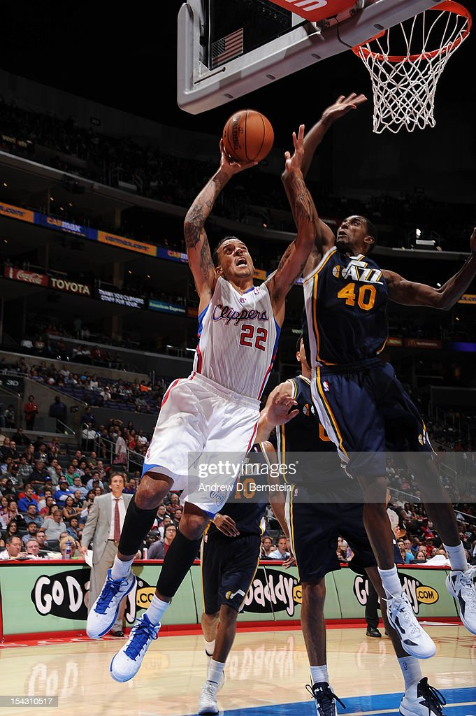 <a gi-track='captionPersonalityLinkClicked' href=/galleries/search?phrase=Matt+Barnes+-+Basketball+Player&family=editorial&specificpeople=202880 ng-click='$event.stopPropagation()'>Matt Barnes</a> #22 of the Los Angeles Clippers goes to the basket against Jeremy Evans #40 of the Utah Jazz during a pre-season game at Staples Center on October 17, 2012 in Los Angeles, California.