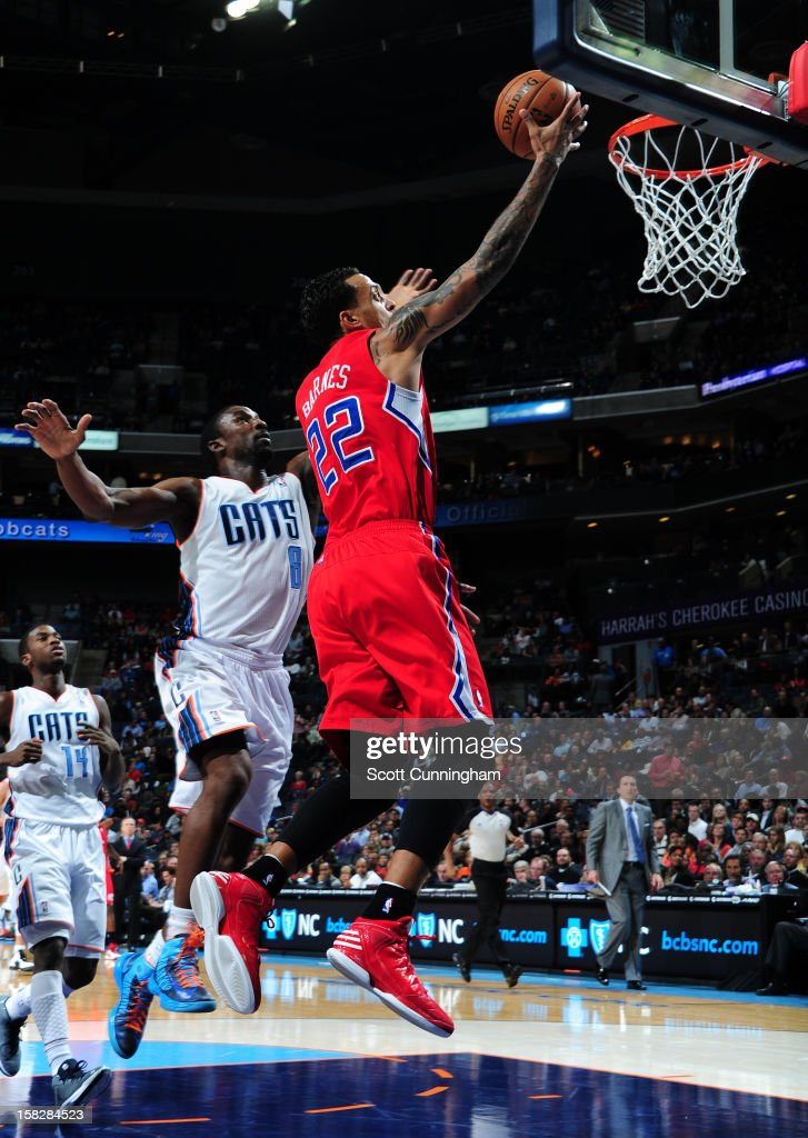 Matt Barnes #22 of the Los Angeles Clippers goes to the basket against Ben Gordon #8 of the Charlotte Bobcats at Time Warner Cable Arena on December 12, 2012 in Charlotte, North Carolina.