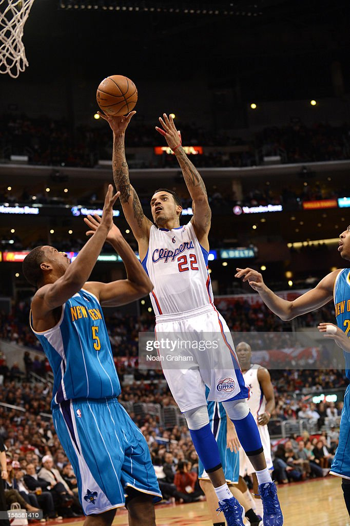 Matt Barnes #22 of the Los Angeles Clippers goes to the basket against Dominic McGuire #5 of the New Orleans Hornets during the game between the Los Angeles Clippers and the New Orleans Hornets at Staples Center on December 19, 2012 in Los Angeles, California.