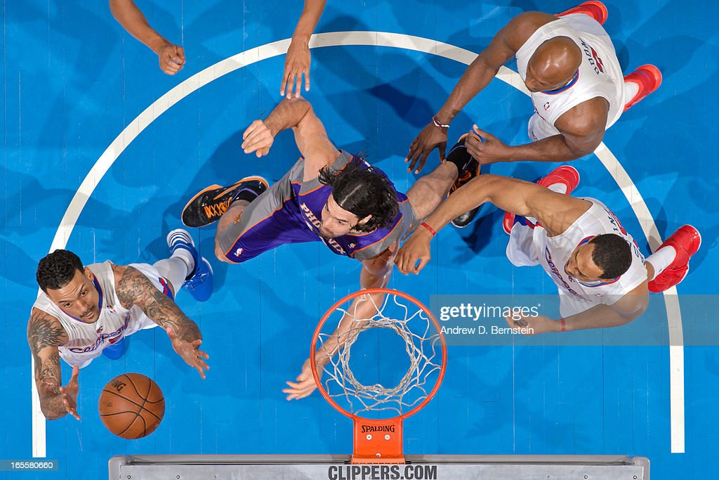 Matt Barnes #22 of the Los Angeles Clippers grabs a rebound against Luis Scola #14 of the Phoenix Suns at Staples Center on April 3, 2013 in Los Angeles, California.