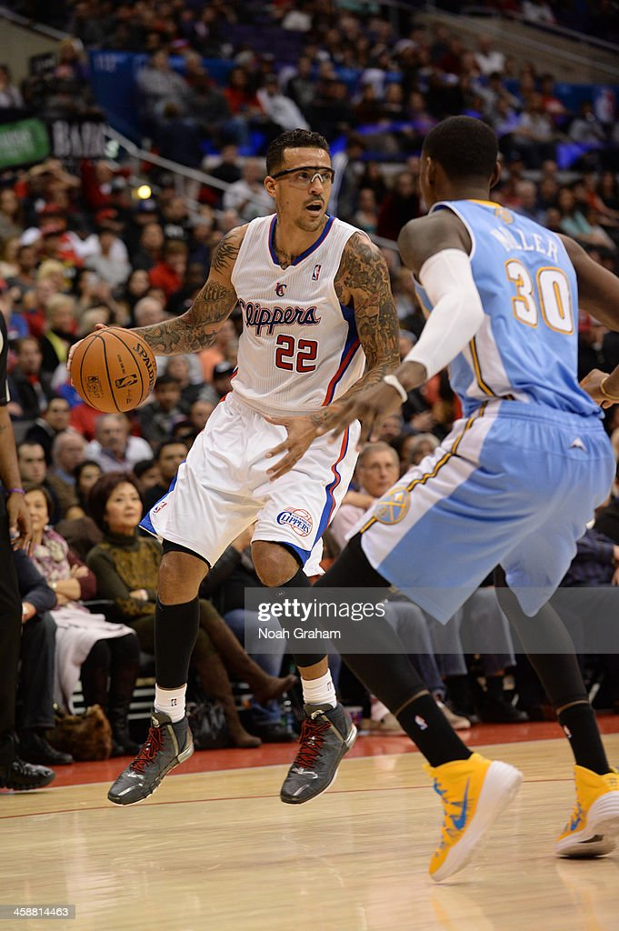 <a gi-track='captionPersonalityLinkClicked' href=/galleries/search?phrase=Matt+Barnes+-+Basketball+Player&family=editorial&specificpeople=202880 ng-click='$event.stopPropagation()'>Matt Barnes</a> #22 of the Los Angeles Clippers handles the ball during a game against the Denver Nuggets at STAPLES Center on December 21, 2013 in Los Angeles, California.