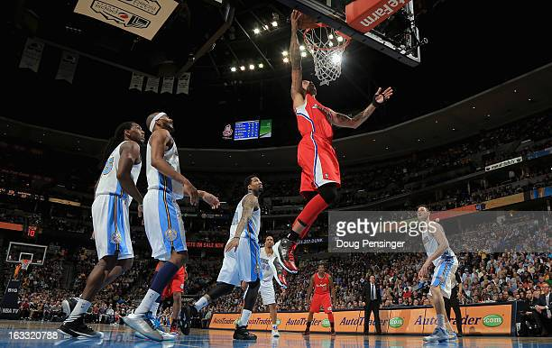 Matt Barnes of the Los Angeles Clippers lays up a shot against the Denver Nuggets at the Pepsi Center on March 7 2013 in Denver Colorado The Nuggets...