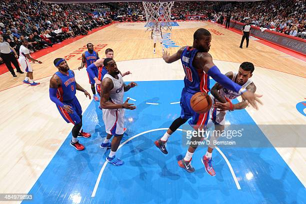 Matt Barnes of the Los Angeles Clippers passes the ball in midair against the Detroit Pistons at STAPLES Center on March 22 2014 in Los Angeles...
