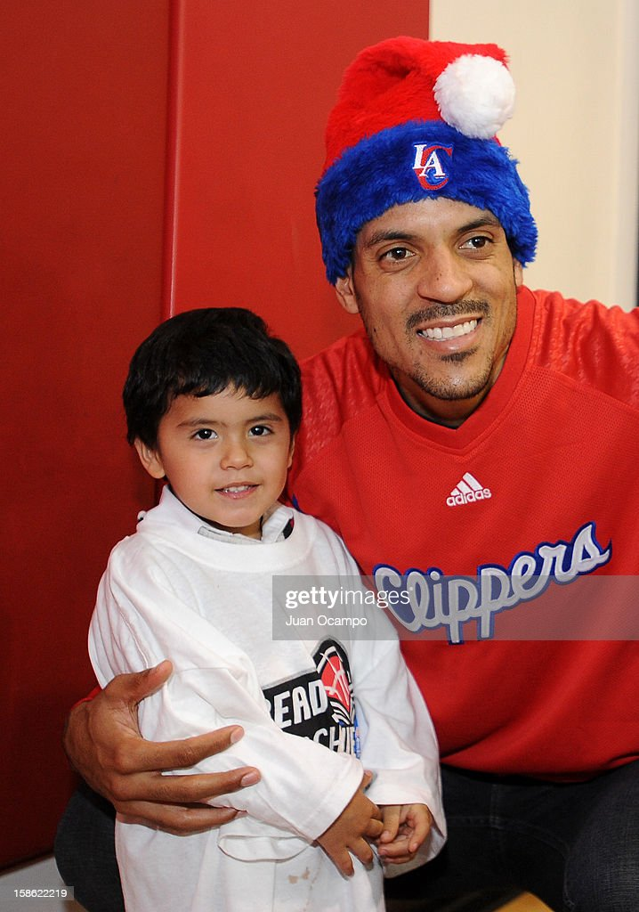 Matt Barnes #22 of the Los Angeles Clippers poses for a photo during the Clippers' 'Season of Giving' Adopt a Family event on December 20, 2012 at Salvation Army Seimon Family Youth & Community Center in Los Angeles, California.