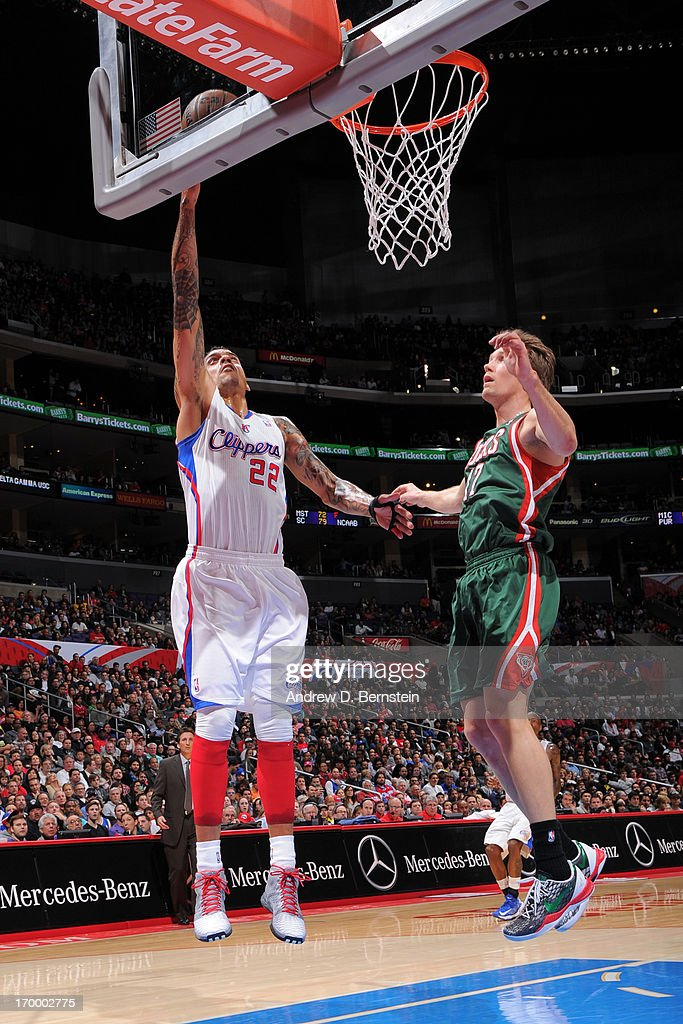 Matt Barnes #22 of the Los Angeles Clippers shoots against Mike Dunleavy, Jr. #17 of the Milwaukee Bucks at Staples Center on March 6, 2013 in Los Angeles, California.