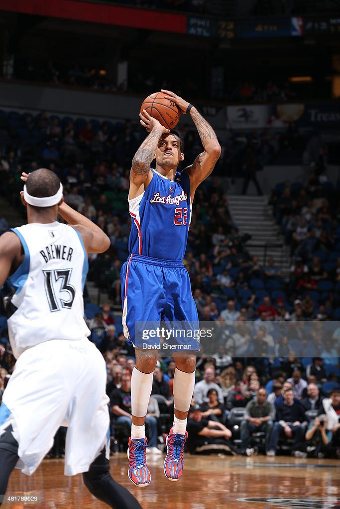 Matt Barnes #22 of the Los Angeles Clippers shoots against the Minnesota Timberwolves on March 31, 2014 at Target Center in Minneapolis, Minnesota.