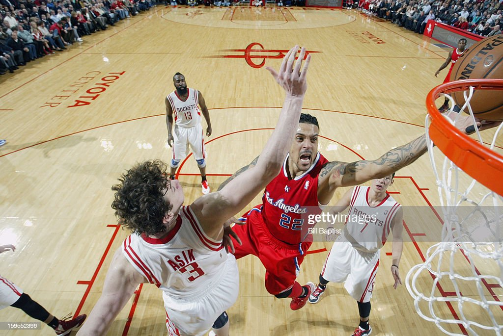 Matt Barnes #22 of the Los Angeles Clippers shoots the ball over Omer Asik #3 of the Houston Rockets on January 15, 2013 at the Toyota Center in Houston, Texas.