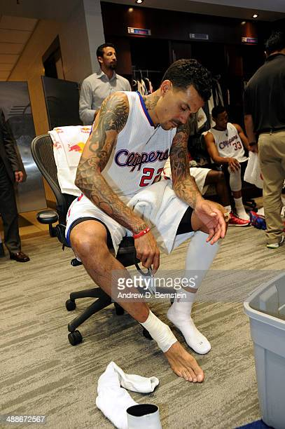 Matt Barnes of the Los Angeles Clippers tapes his ankle before a game against the Golden State Warriors in Game Seven of the Western Conference...