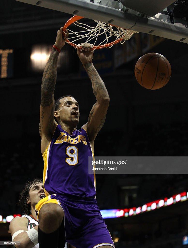 Matt Barnes of the Los Angeles Lakers dunks the ball over Andrew Bogut of the Milwaukee Bucks at the Bradley Center on November 16 2010 in Milwaukee...