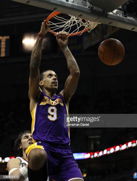 Matt Barnes of the Los Angeles Lakers dunks the ball over Andrew Bogut of the Milwaukee Bucks at the Bradley Center on November 16 2010 in Milwaukee...