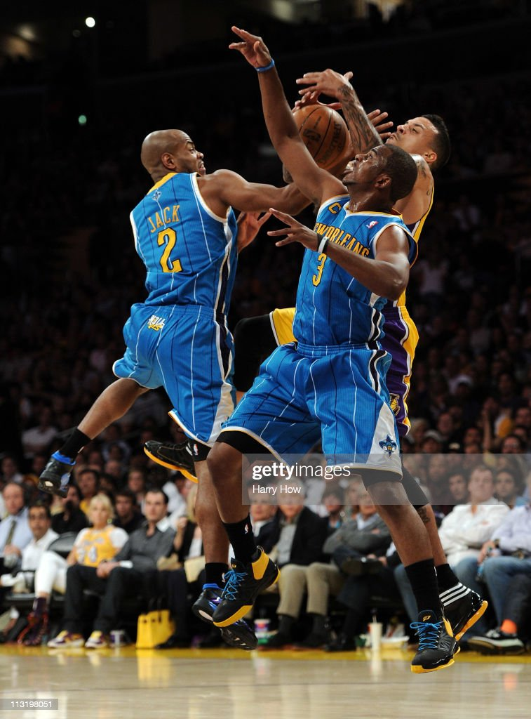 Matt Barnes of the Los Angeles Lakers goes up for a rebound between Jarrett Jack and Chris Paul of the New Orleans Hornets in the first half in Game...