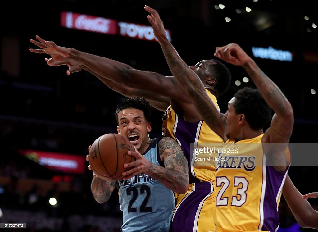 <a gi-track='captionPersonalityLinkClicked' href=/galleries/search?phrase=Matt+Barnes+-+Basketball+Player&family=editorial&specificpeople=202880 ng-click='$event.stopPropagation()'>Matt Barnes</a> #22 of the Memphis Grizzlies drives to the basket against <a gi-track='captionPersonalityLinkClicked' href=/galleries/search?phrase=Louis+Williams&family=editorial&specificpeople=670315 ng-click='$event.stopPropagation()'>Louis Williams</a> #23 and <a gi-track='captionPersonalityLinkClicked' href=/galleries/search?phrase=Brandon+Bass&family=editorial&specificpeople=233806 ng-click='$event.stopPropagation()'>Brandon Bass</a> #2 of the Los Angeles Lakers during the second half of a game at Staples Center on March 22, 2016 in Los Angeles, California.