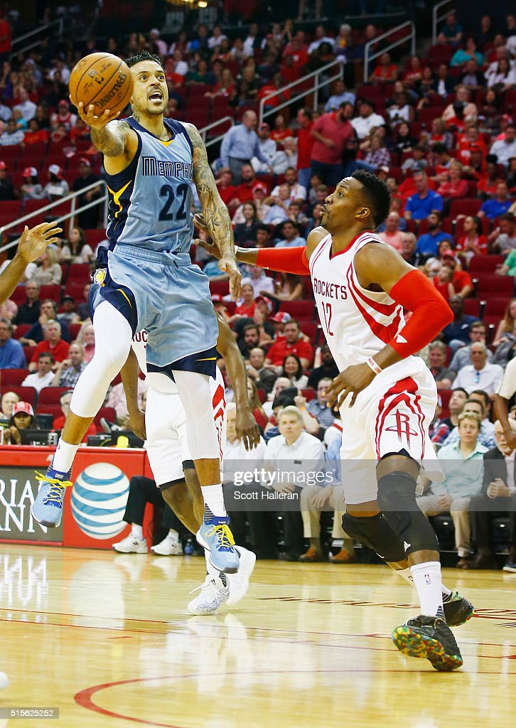 Matt Barnes of the Memphis Grizzlies drives with the basketball over Dwight Howard of the Houston Rockets during their game at the Toyota Center on...