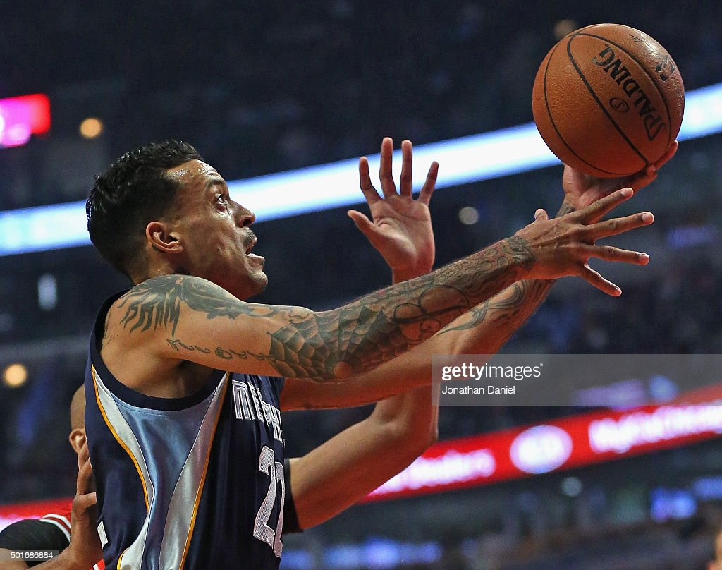 Matt Barnes of the Memphis Grizzlies goes up for a shot past Taj Gibson of the Chicago Bulls at the United Center on December 16 2015 in Chicago...