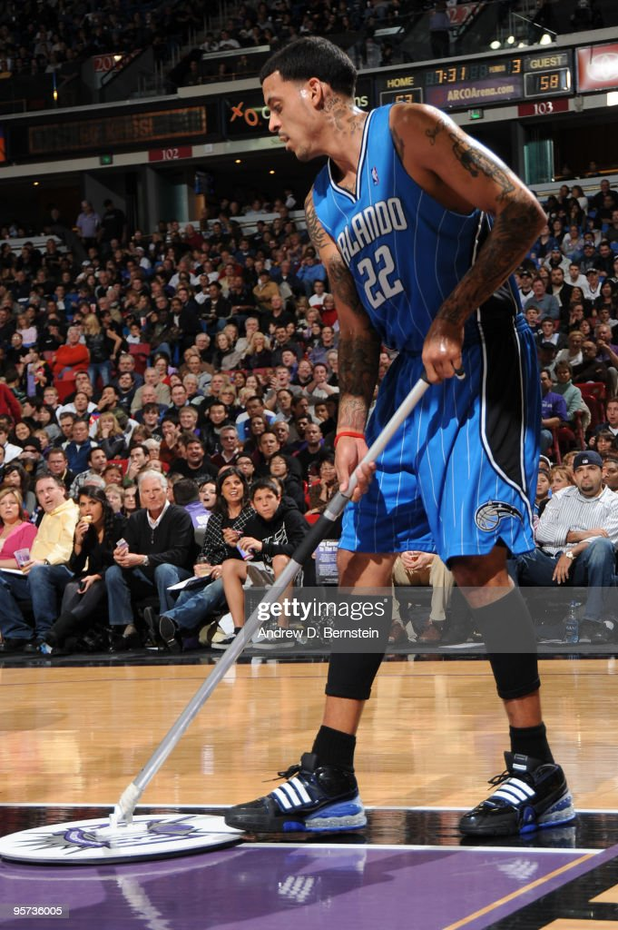 Matt Barnes of the Orlando Magic wipes up a wet spot during the game against the Sacramento Kings on January 12 2010 at Arco Arena in Sacramento...