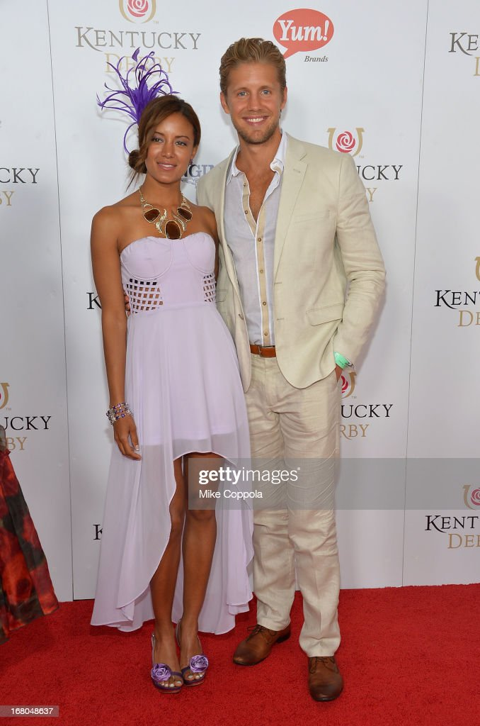 Matt Barr (R) and Heather Hemmens celebrate the 139th Kentucky Derby with Moet & Chandon at Churchill Downs on May 4, 2013 in Louisville, Kentucky.