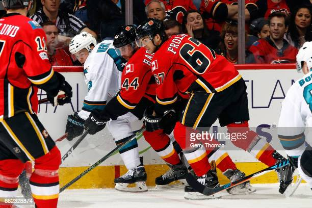 Matt Bartkowski and Michael Frolik of the Calgary Flames skate against Tomas Hertl of the San Jose Sharks during an NHL game on March 31 2017 at the...
