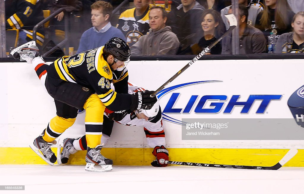Matt Bartkowski #43 of the Boston Bruins checks <a gi-track='captionPersonalityLinkClicked' href=/galleries/search?phrase=Stephen+Gionta&family=editorial&specificpeople=817969 ng-click='$event.stopPropagation()'>Stephen Gionta</a> #11 of the New Jersey Devils against the boards in the second period during the game on April 2, 2013 at TD Garden in Boston, Massachusetts.