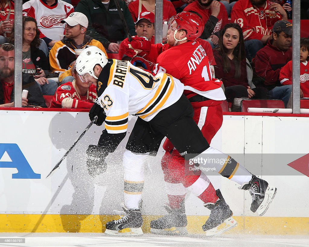 <a gi-track='captionPersonalityLinkClicked' href=/galleries/search?phrase=Matt+Bartkowski&family=editorial&specificpeople=7203779 ng-click='$event.stopPropagation()'>Matt Bartkowski</a> #43 of the Boston Bruins hits Joakim Andersson #18 of the Detroit Red Wings during Game Three of the First Round of the 2014 Stanley Cup Playoffs on April 22, 2014 at Joe Louis Arena in Detroit, Michigan.