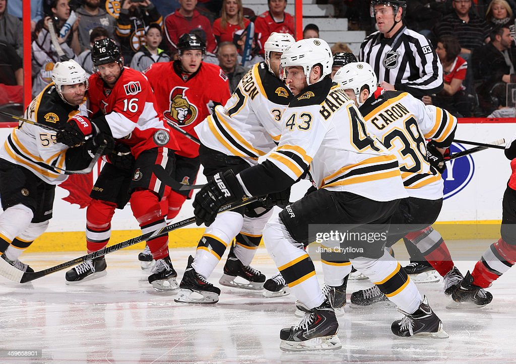 <a gi-track='captionPersonalityLinkClicked' href=/galleries/search?phrase=Matt+Bartkowski&family=editorial&specificpeople=7203779 ng-click='$event.stopPropagation()'>Matt Bartkowski</a> #43 of the Boston Bruins keeps his eye on the puck as it floats above his stick during an NHL game against the Ottawa Senators at Canadian Tire Centre on December 28, 2013 in Ottawa, Ontario, Canada.