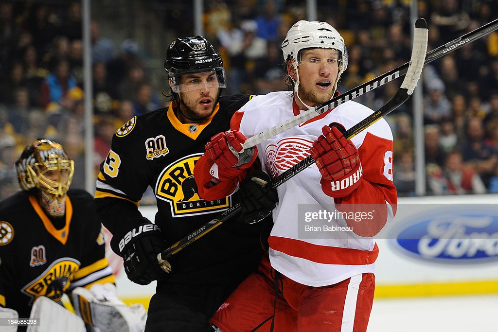 <a gi-track='captionPersonalityLinkClicked' href=/galleries/search?phrase=Matt+Bartkowski&family=editorial&specificpeople=7203779 ng-click='$event.stopPropagation()'>Matt Bartkowski</a> #43 of the Boston Bruins watches the play against <a gi-track='captionPersonalityLinkClicked' href=/galleries/search?phrase=Justin+Abdelkader&family=editorial&specificpeople=2271858 ng-click='$event.stopPropagation()'>Justin Abdelkader</a> #8 of the Detroit Red Wings at the TD Garden on October 14, 2013 in Boston, Massachusetts.