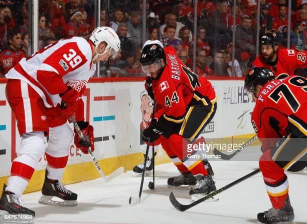 Matt Bartkowski of the Calgary Flames battles against the Detroit Red Wings at Scotiabank Saddledome on March 3 2017 in Calgary Alberta Canada