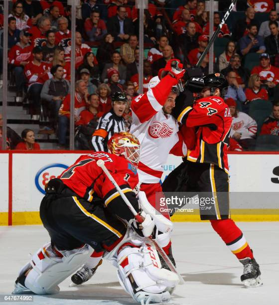 Matt Bartkowski of the Calgary Flames battles in front against the Detroit Red Wings at Scotiabank Saddledome on March 3 2017 in Calgary Alberta...