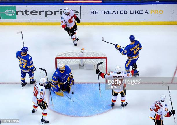 Matt Bartkowski of the Calgary Flames celebrates with Sean Monahan and Micheal Ferland after scoring against Jake Allen of the St Louis Blues on...
