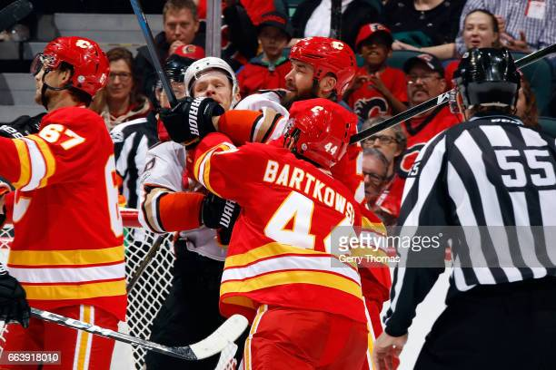 Matt Bartkowski of the Calgary Flames checks Corey Perry of the Anaheim Ducks during an NHL game on April 2 2017 at the Scotiabank Saddledome in...