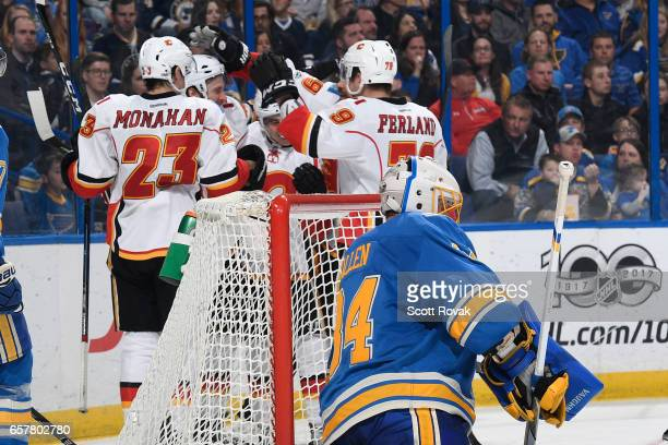 Matt Bartkowski of the Calgary Flames is congratulated after scoring a goal against the St Louis Blues on March 25 2017 at Scottrade Center in St...