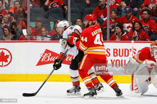 Matt Bartkowski of the Calgary Flames skates against Chris Wagner of the Anaheim Ducks during an NHL game on April 2 2017 at the Scotiabank...