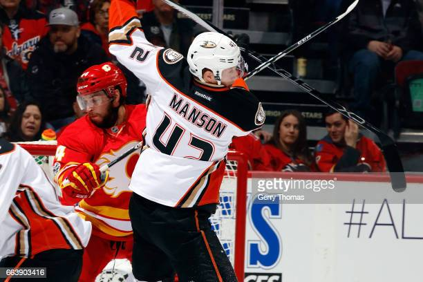 Matt Bartkowski of the Calgary Flames skates against Josh Manson of the Anaheim Ducks during an NHL game on April 2 2017 at the Scotiabank Saddledome...