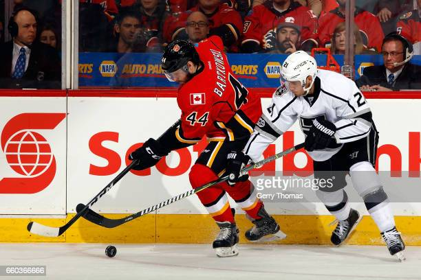 Matt Bartkowski of the Calgary Flames skates against Nick Shore of the Los Angeles Kings during an NHL game on March 29 2017 at the Scotiabank...
