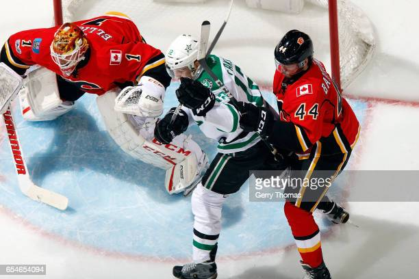 Matt Bartkowski of the Calgary Flames skates against Patrick Sharp of the Dallas Stars during an NHL game on March 17 2017 at the Scotiabank...