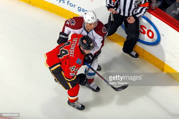 Matt Bartkowski of the Calgary Flames skates against Rene Bourque of the Colorado Avalanche during an NHL game on March 27 2017 at the Scotiabank...