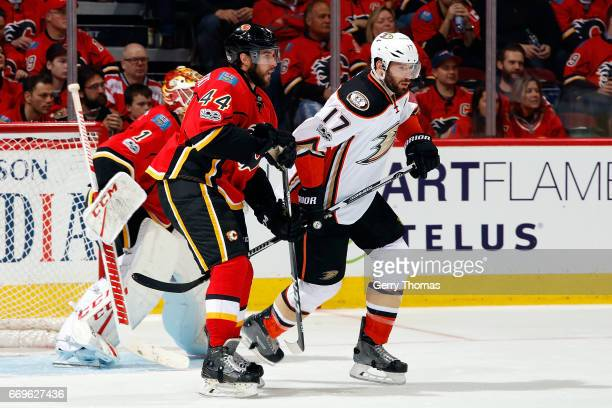 Matt Bartkowski of the Calgary Flames skates against Ryan Kesler of the Anaheim Ducks during Game One of the Western Conference First Round during...