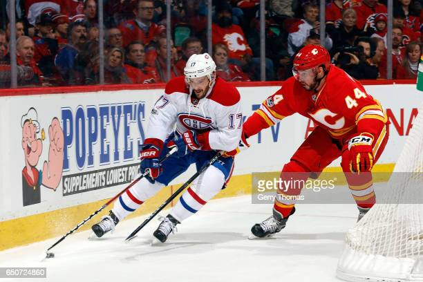 Matt Bartkowski of the Calgary Flames skates against Torrey Mitchell of the Montreal Canadiens during an NHL game on March 9 2017 at the Scotiabank...