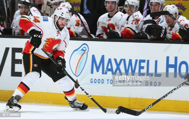 Matt Bartkowski of the Calgary Flames skates with the puck in Game One of the Western Conference First Round against the Anaheim Ducks during the...