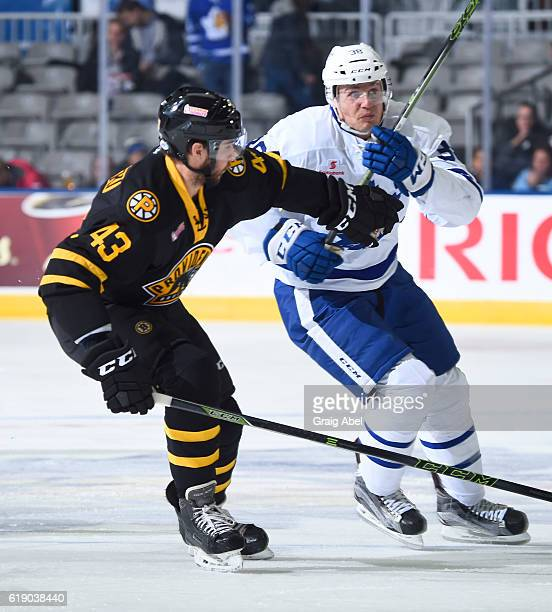 Matt Bartkowski of the Providence Bruins puts a hold on Colin Greening of the Toronto Marlies during game action on October 26 2016 at Ricoh Coliseum...