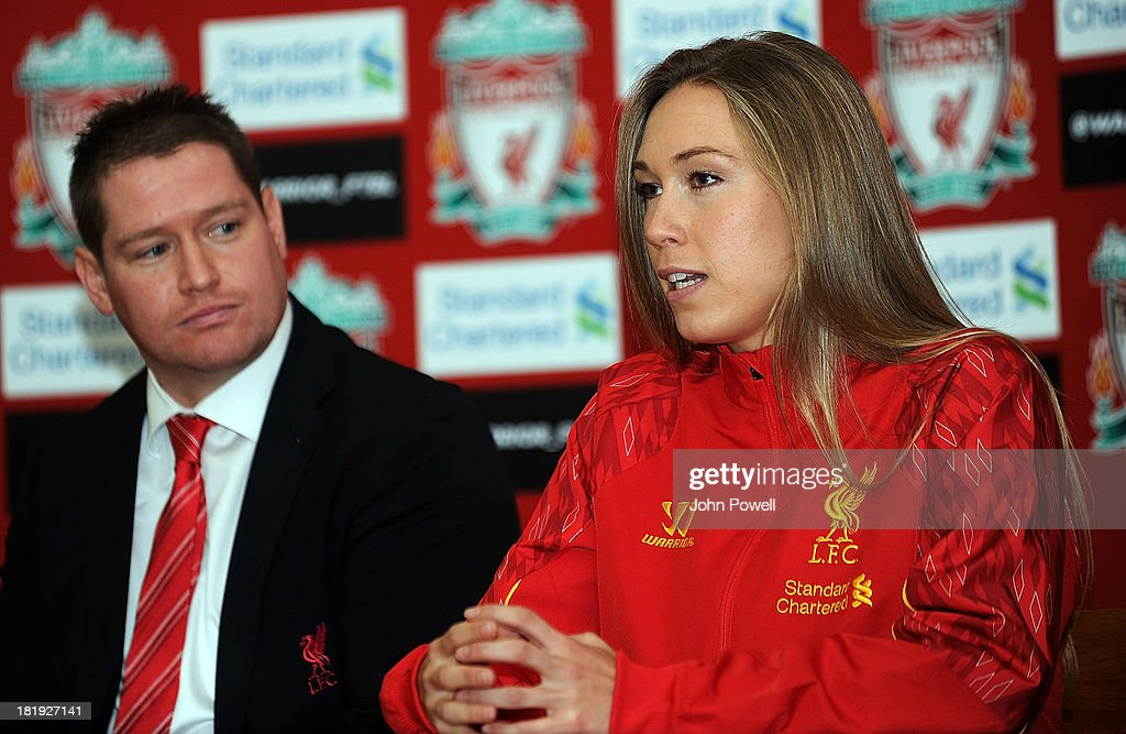 Matt Beard Liverpool FC Ladies Manager looks on as Whitney Engen Liverpool FC Ladies Player speaks at a Press Conferenceat Melwood Training Ground on September 26, 2013 in Liverpool, England.