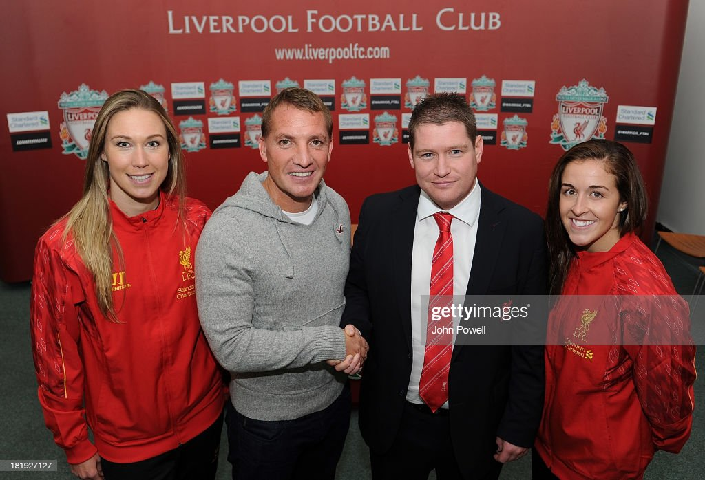 Matt Beard Liverpool FC Ladies Manager shakes hands with Brendan Rodgers Manager of Liverpool who wishes him 'Good Luck' for the game on Sunday also in the photo is Whitney Engen (Left) Liverpool FC Ladies player and Amanda Da-Costa Liverpool FC Ladies player at Melwood Training Ground on September 26, 2013 in Liverpool, England.