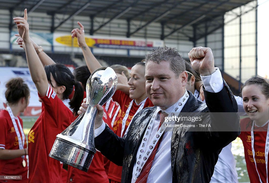 Matt Beard manager of Liverpool Ladies with the Women's Super League Trophy following the match between Liverpool Ladies FC and Bristol Academy Women's FC at Halton Stadium on September 29, 2013 in Widnes, England.